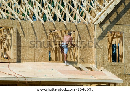 a construction worker working on building a new home