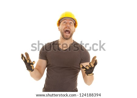 A construction worker yelling up at something. - stock photo
