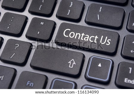 A 'contact us' message on enter key of keyboard, for online communications. - stock photo