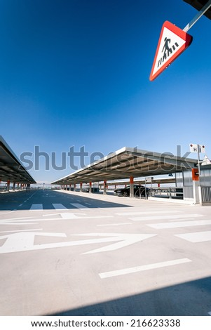 A contemporary car park in Barcelona, Spain. The use of a wide angle lens exaggerating the angles and perspective. - stock photo