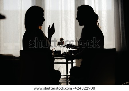 a conversation between two girls - stock photo