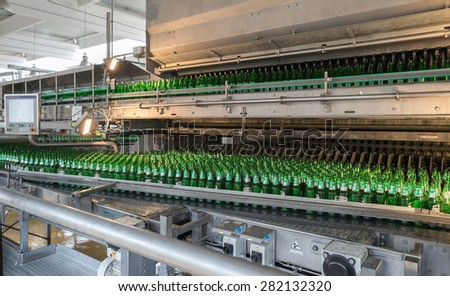 A conveyor belt with empty bottles for beer is seen during production process in the  Molson Coors Kamenitza brewery, April 28, 2015, near the city of Haskovo, Bulgaria.
