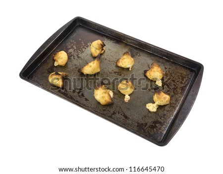 A cookie sheet with several home cooked crab rangoon appetizers on a white background. - stock photo