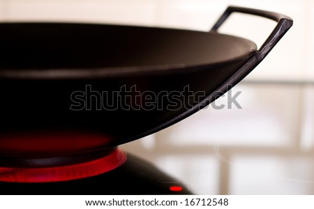 a cooking pan on a hot plate - stock photo