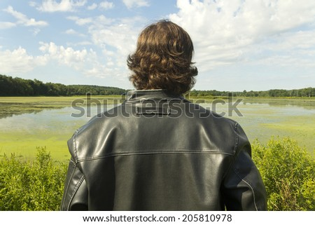 A cool guy takes in the gorgeous view - stock photo