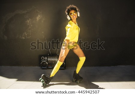 a cool roller skating woman dances and skates outside in an urban setting
