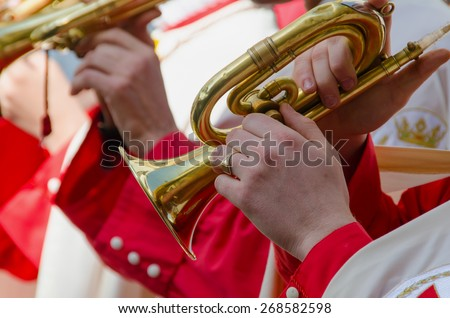 A cornet player plays his istrument in a parade - stock photo