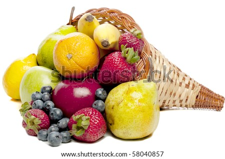 A Cornucopia with fruit celebrating the years bountiful harvest. - stock photo