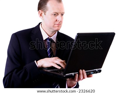 A corporate businessman working on his laptop, isolated on white background.