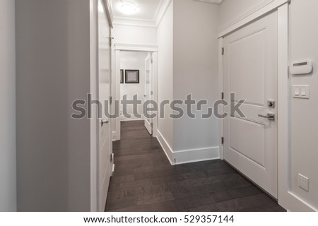 A Corridor Of A House With The Rooms At The End. Interior Design.