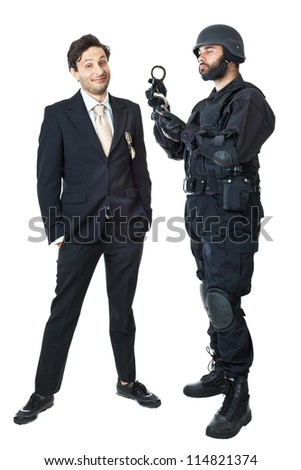 a corrupted businessman being arrested by a swat agent - stock photo