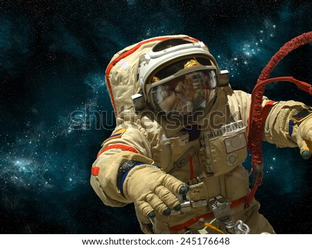 A cosmonaut floats in deep space against a background of stars and nebula. Elements of this image furnished by NASA. - stock photo