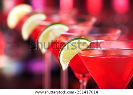 A cosmopolitan, is a cocktail made with vodka, triple sec, cranberry juice, and freshly squeezed lime juice or sweetened lime juice. - stock photo