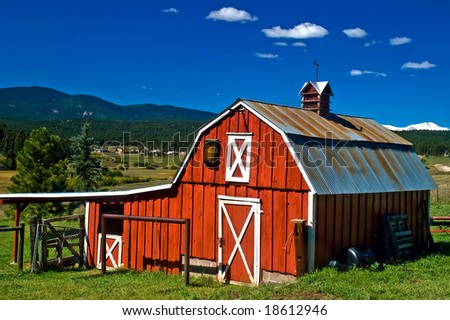 A country barn under blue sky, captured in the rural Colorado Rocky Mountains