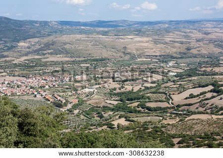 A countryside landscape closed to Giara di Gesturi in Sardinia. On the picture is seen the village Gesturi. - stock photo