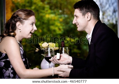 a couple at the diner, man proposing marriage - stock photo