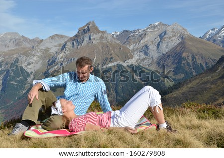 A couple enjoying Alpine panorama. Switzerland - stock photo