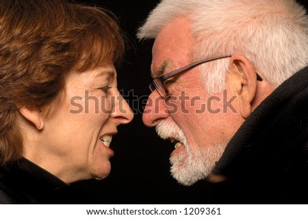 A couple fight and go head to head. - stock photo