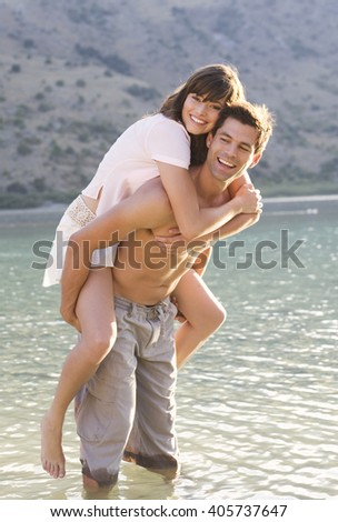 A couple having fun in a lake