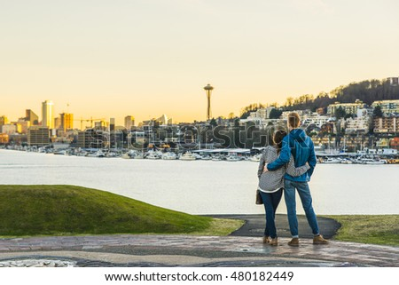 a couple hug and looking Seattle city landscape with sunset ,Seattle,Washington,USA..