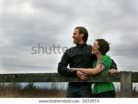 a couple in a countryside setting - stock photo