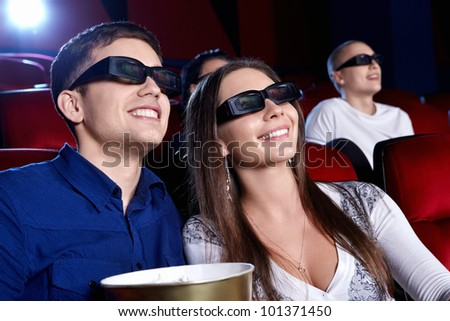 A couple in a movie theater - stock photo