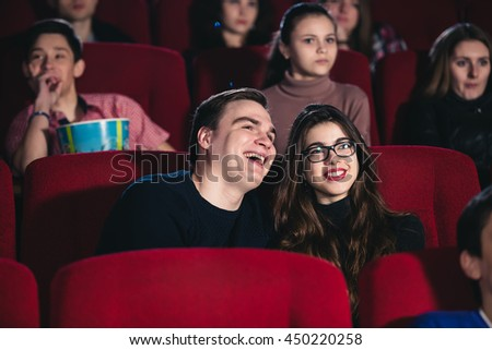 A couple in love in a movie theater