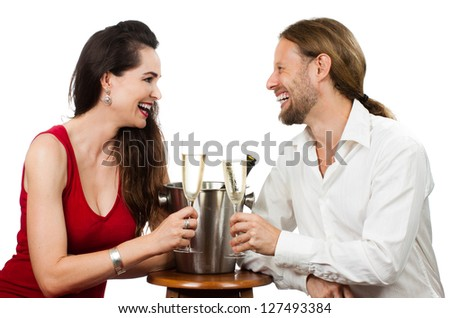 A couple in love on a date doing cheers with Champagne. Isolated on white. - stock photo