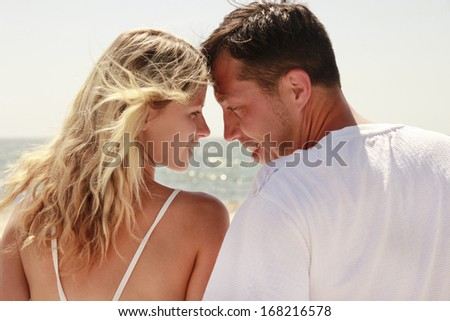 a couple in love on the shore of the sea