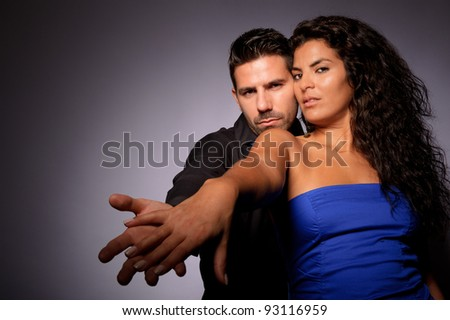 A couple in love together holding hands - stock photo