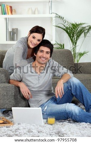 a couple in the lounge - stock photo