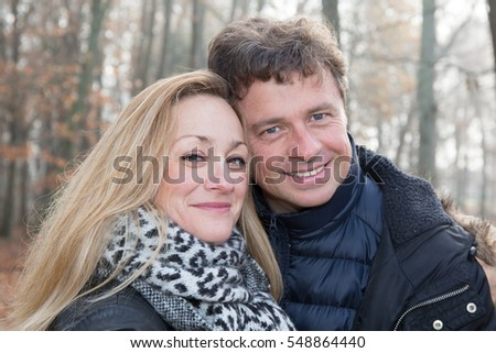 A couple in the woods or park in tenderness and affection