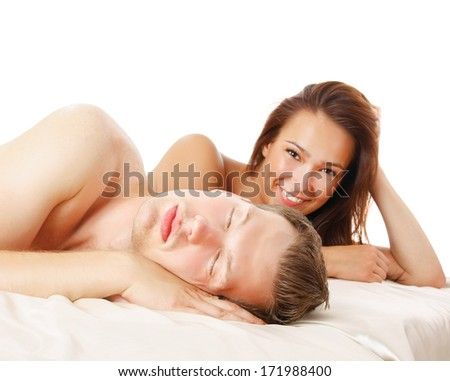 A couple is lying in bed on white background