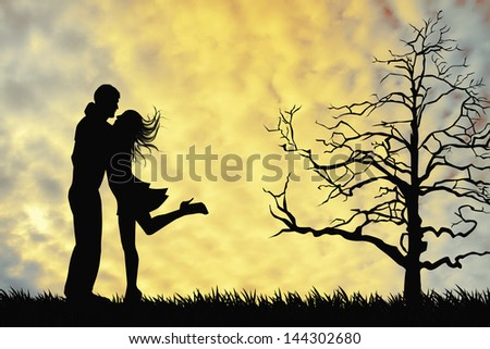 a couple kissing at sunset - stock photo