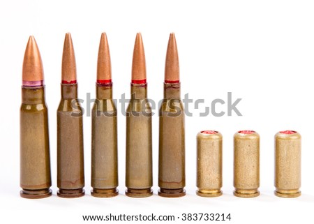 a couple of bullets on a white background ammunition of rifled carabine - stock photo