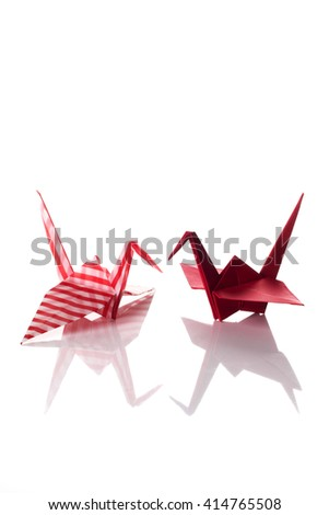 A couple of cranes origami made of decorated paper isolated on white background. - stock photo