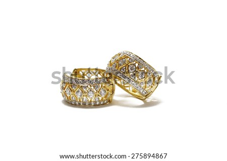 A couple of diamond gold earrings on isolated pure white background