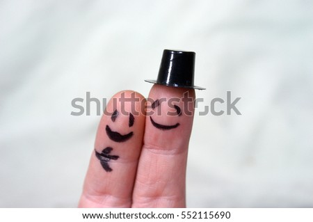 A couple of finger drawn puppets close for a hug.