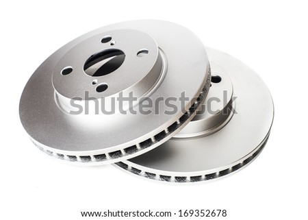 A couple of new car brake disks isolated on white  - stock photo