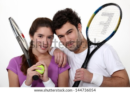 A couple of tennis players. - stock photo
