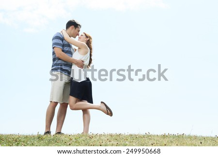 A couple outside having fun together outside - stock photo