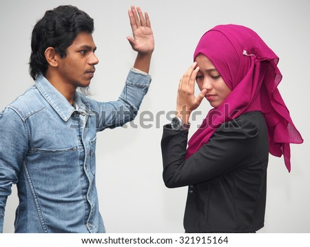 A couple quarreling with the male being abusive. - stock photo
