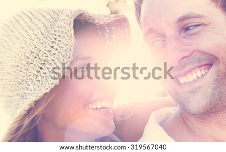 A couple relaxing on the beach romantic love concept - stock photo