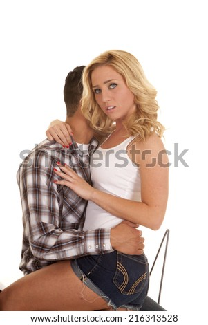 A couple showing their desire by sitting really close together. - stock photo