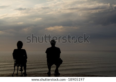 a couple sitting on two chairs