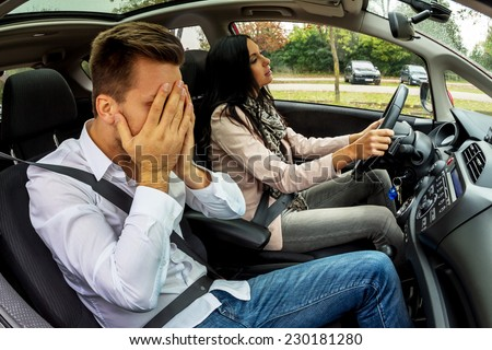 a couple traveling in a car - stock photo
