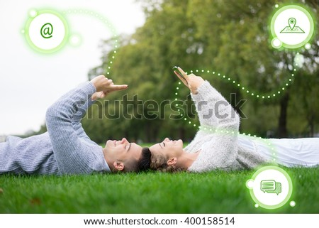 A couple using social media and mobile phone - stock photo