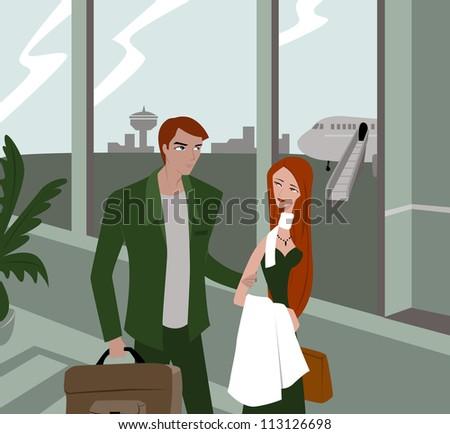 A couple walking through an airport - stock photo