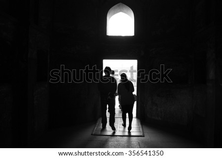 A couple walking towards the light