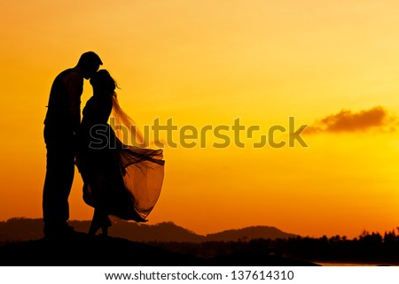 a couple wedding on the beach at the sunset - stock photo